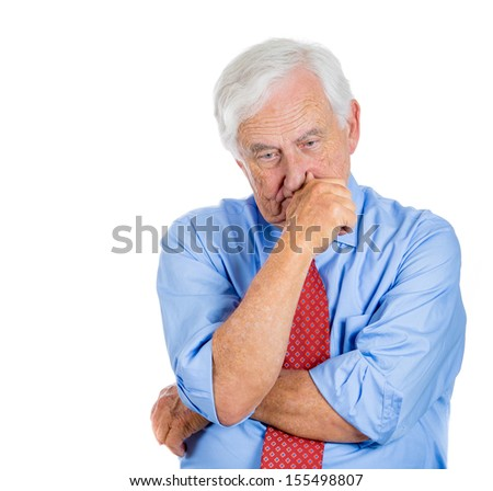 A close-up portrait of an elderly executive, old corporate employee, grandfather, senior man deep in thought, troubled with something, sad and concerned, isolated on a white background