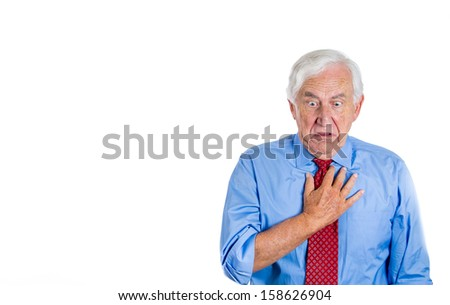 A close-up portrait of an elderly male executive, old corporate employee having sudden chest, heart pain, trying to catch up the air, suffocating, isolated on a white background