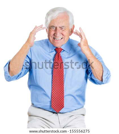 A close-up portrait of elderly man suffering from a severe migraine or bad news or trying to remember, recall some information, isolated on a white background. Geriatrics, memory loss, health issues.