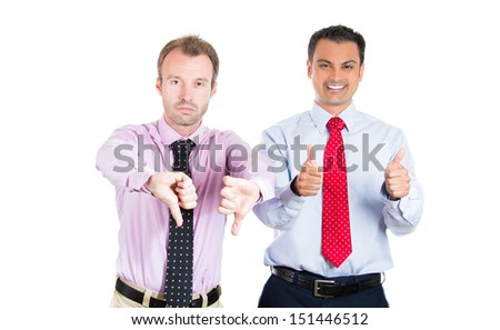 A close-up portrait of two businessman, friends; one being excited, smiling, showing thumbs-up, the other serious, concerned, showing thumbs down; isolated on a white background. Emotion contrasts
