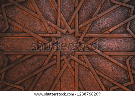 A close up shot of a metal door having beautiful and intricate designs.