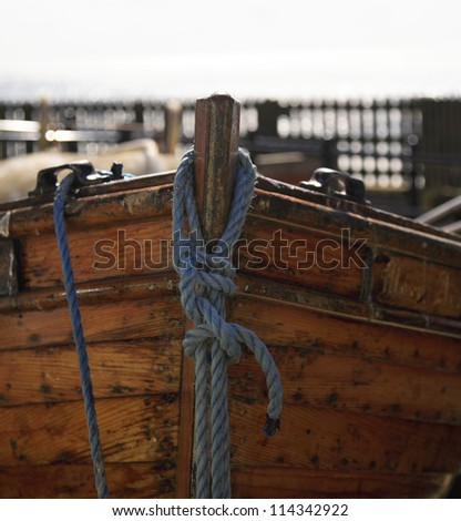 A close up shot of a moored rowing boat