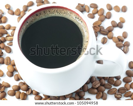 A close up shot of a white cup filled with coffee