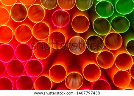 A close up shot of colored straws. The straws are used to drink drinks without putting your mouth to the glass. The plastic they are made of does cause environmental pollution #1407797438