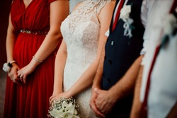 A close up shot of hands of bride, groom, bridesmaid, maid in honor