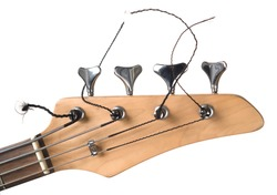 A close up shot of the headstock of a bass guitar.
