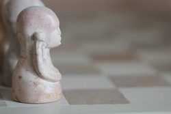 a close-up shot of the stone chess