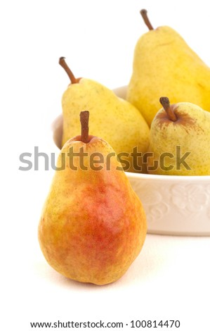 A Close Up Still Life on White of a Four Nutritious Bartlett Pears Ripe and Ready to Eat, the most commonly grown pear in the United States of America and Canada - stock photo
