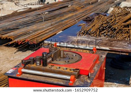 A close-up view of a specific machine using for bending of armatures at the construction site.