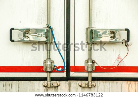 A close up view of closed and secured truck doors.