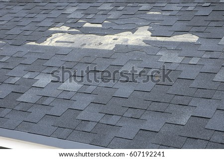 A close up view of shingles a roof damage