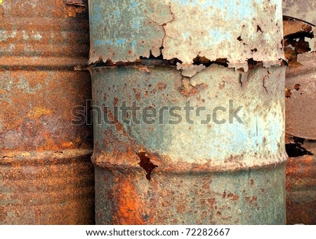 A close view of rusted out oil barrels
