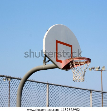 A close view of the basketball backboard net goal hoop in the park with the sky in the background.  - Shutterstock ID 1189692952