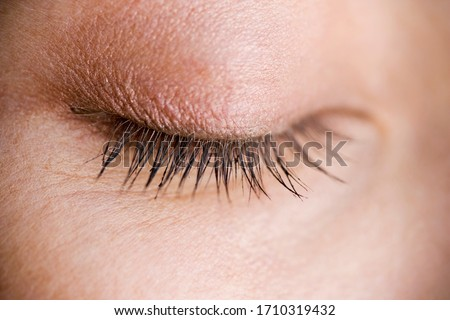 A closed woman's eye and eyelashes