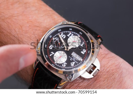 A closeup image of a man's wristwatch