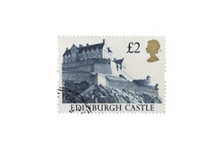 A Closeup Macro photograph isolated on a white background of a used British definitive £2 stamp featuring Edinburgh Castle in Scotland issued in 1992 by the British Postal Service