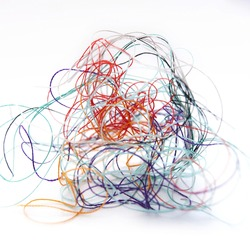 A closeup multi-colored tangled colorful needlecraft isolated on a white background