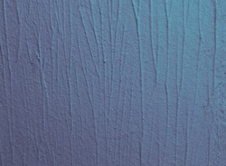 A closeup of a blue old, weathered wall texture with bumpy lines
