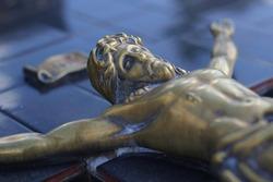 A closeup of a bronze sculpture of Jesus.