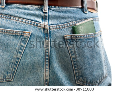 A closeup of a check book in the back pocket of blue jeans, isolated on white.