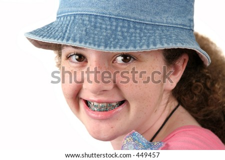 A closeup of a cute teen-aged girl with braces