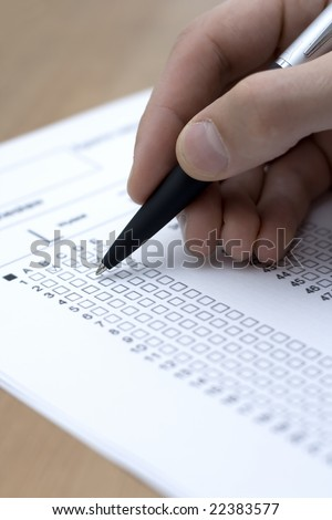 A closeup of a fill testing form with a pen