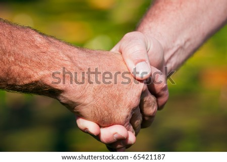 A closeup of a friendly handshake between two men