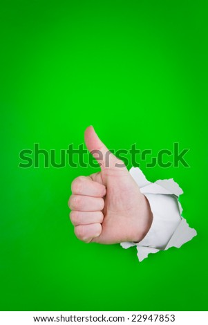A closeup of a hand, giving the thumbs up.