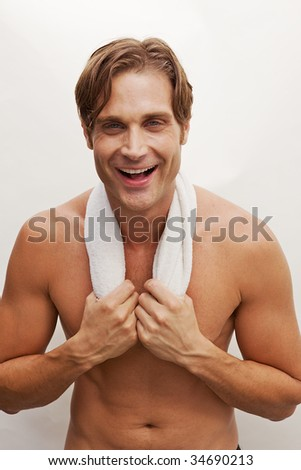 A Closeup of a happy man with no shirt and a towel #34690213