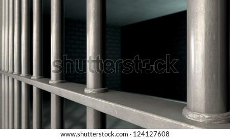 A closeup of a jail cells iron bars - stock photo