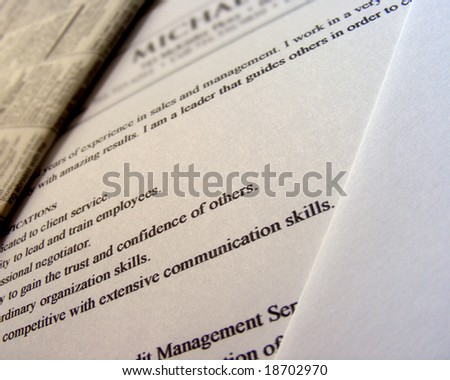 A closeup of a Resume with qualifications in focus. The color usage is a brown.