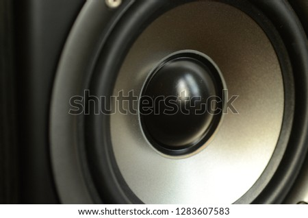 A closeup of a stereo speaker