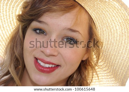 A closeup of a young Woman in a sun hat.