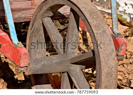 A closeup of an old wheelbarrow wheel in Allaire Village, New Jersey. Allaire village was a bog iron industry town in New Jersey during the early 19th century.