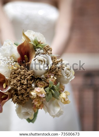 A closeup of bouquet held by a bride - stock photo