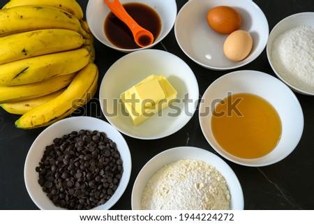 A closeup of bowls of baking ingredients for balking banana and chocolate cake Stockfoto ©