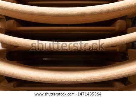 A closeup of folded light colour wooden folding chairs #1471435364