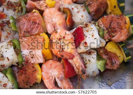 A closeup of prepared fish kebabs for sale at a French market