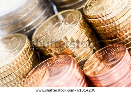 A closeup of stacks of Euro coins in different denominations