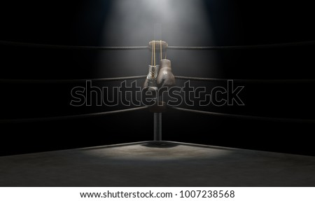A closeup of the corner of an old vintage boxing ring surrounded by ropes spotlit by a spotlight on an isolated dark background - 3D render Foto stock ©
