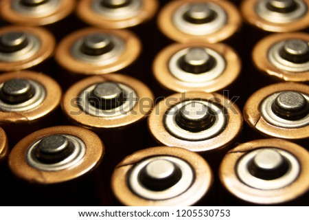 A closeup of the positive ends of battery cells.  #1205530753