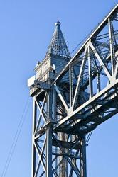 A closeup of the top part of a tower of the Cape Cod Canal Railroad Bridge, a vertical lift bridge in Bourne, Massachusetts near Buzzards Bay.