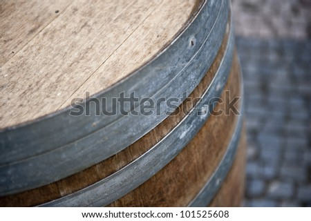 A closeup picture of a wooden barrel for a keg of beer.