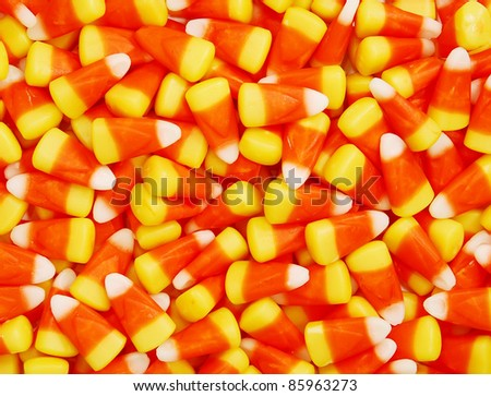 A closeup pile of colorful Halloween candy corn