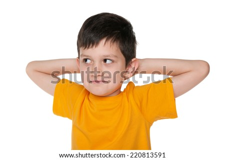 A closeup portrait of a dreaming young boy on the white background