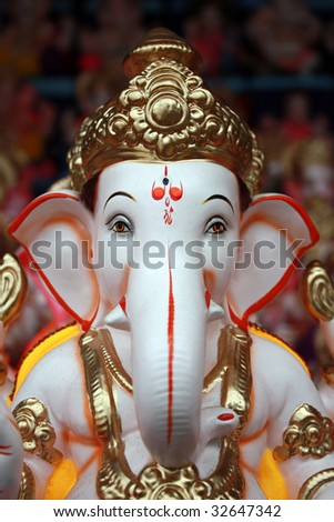 A closeup portrait of the face of Lord Ganesha Idol for sale on the eve of Ganesh festival in India.