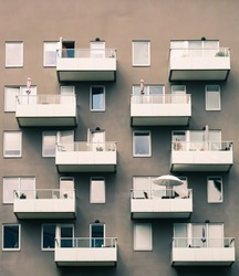 A closeup shot of a big residential building with balconies