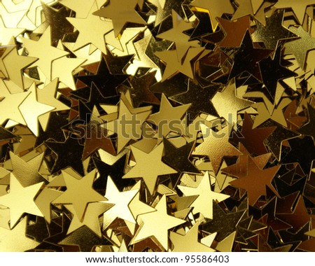A closeup shot of a bunch of star shaped confetti.