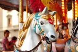 A closeup shot of a merry-go-round horse