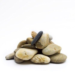 A closeup shot of a pile of pebbles isolated on the white background